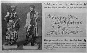 Пара фигур Allach в народных костюмах из серии Siebenburgische Trachtenfiguren, сопровождающаяся поздравительной открыткой «В честь дня рождения соратника», подписанная Гиммлером.